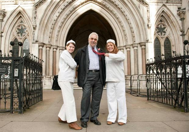 Malcolm Bell being accosted by two sailors outside the Royal Courts of Justice for the charity stunt