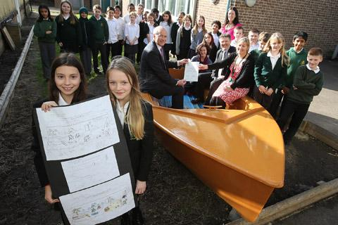 Former pupils Charlotte Baldry (11) and Marnie Wheeler (11) with their designs to improve outdoor spaces at Oakdale Junior School beside the eBay boat