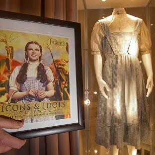 The dress worn by Judy Garland in the Wizard Of Oz has been sold for more than 300,000 pounds film. The dress is on display at the Stafford Hotel in London before being auctioned in Beverly Hills on November