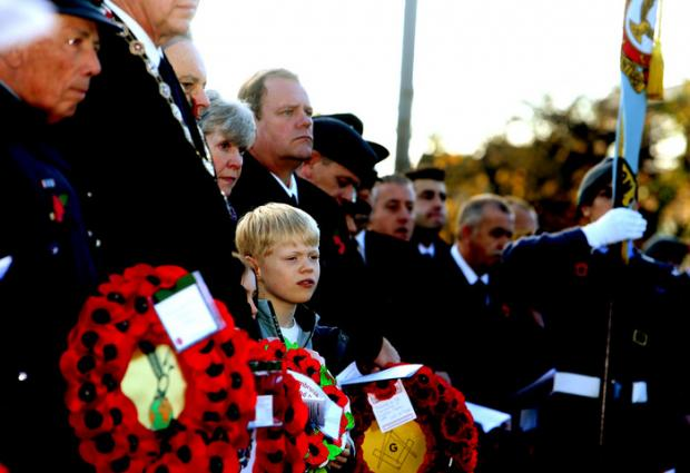 East London and West Essex Guardian Series: Crowds watch the wreath-laying ceremony in Loughton.