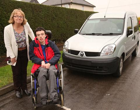 Karen Wright with 15-year-old son James beside their mobility van