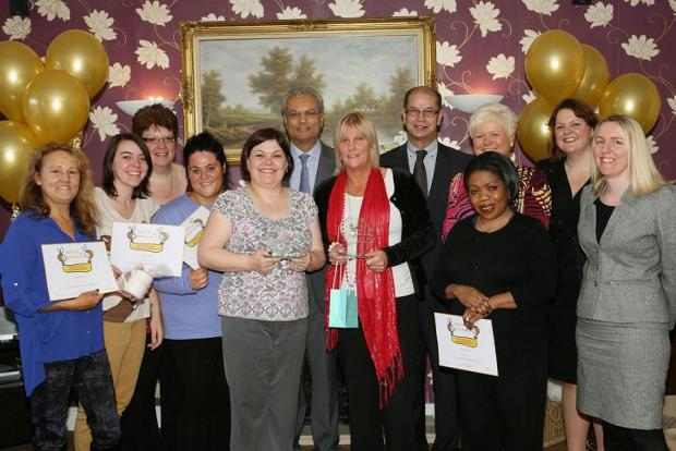 Jacky Fitzpatrick and Jackie Berritt (front centre) with other winners and employees of Carebase
