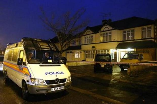 Police at the cordoned off house on Clayhall Avenue last night