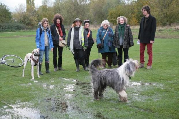 Campaigners and Jenny Jones (second from right) examine surface water at Leyton Marsh. Photo by Karl Weiss.