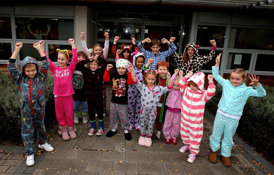 Pyjamas and bedtime stories as pupils read for Children in Need