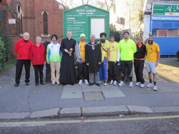 Sikhs In The City runners and organisers with the Mayor of Redbridge and Father Stuart Halstead