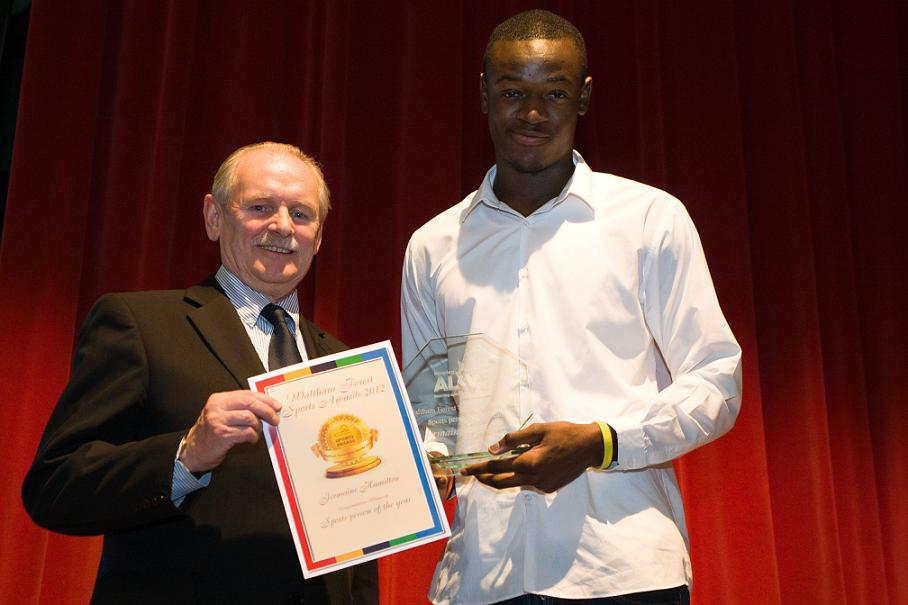 Cllr Robbins with promising young runner Jermaine Hamilton at the awards ceremony.