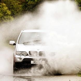 Drivers have been warned to take extra care on the roads after heavy rain