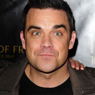 Robbie Williams has been bruised by criticism of his earlier music