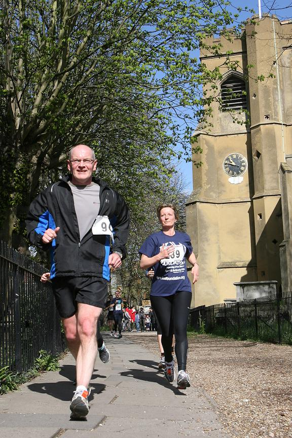 Runners racing past St Mary's Church in Walthamstow Village during the KNI's event earlier this year.