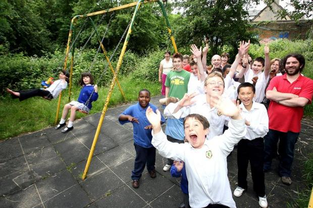 Rob Dighton, far right, with children and the swing bought my money awarded by the Gannett Foundation in 2008