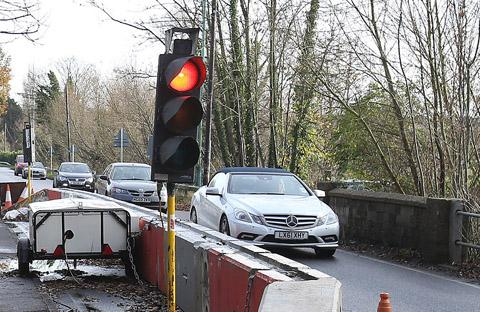 Traffic lights causing havoc near damaged bridge set to stay in place for a year