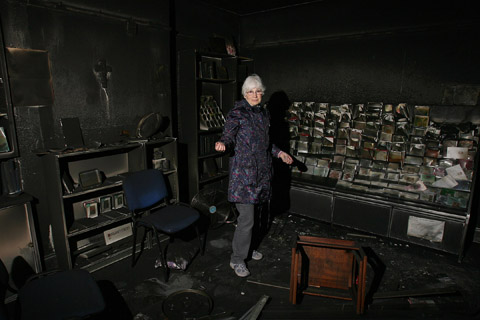 Volunteer Sue Catmur in the fire damaged Christian centre