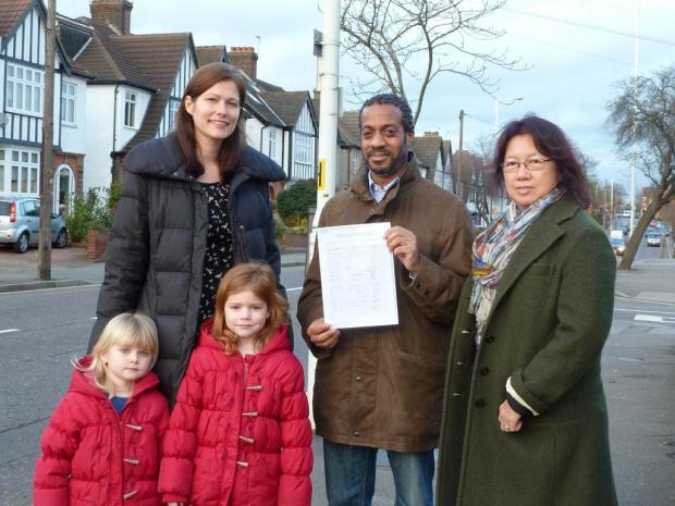 Louise Arnold, Errol Denton and Michelle Wood in St Barnabas Road with the petition they presented to councillors
