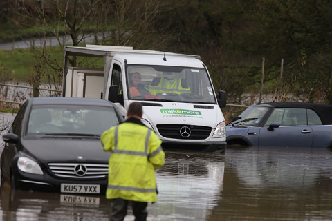 Three fire crews called to rescue motorist trapped in flood waters