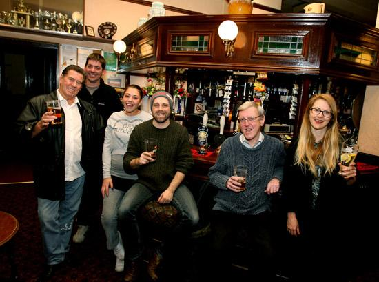 Regulars celebrate the saving of the Birkbeck Tavern