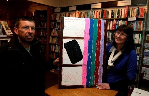 Paul Cates and Alison Lawrence with Books vs Kindle