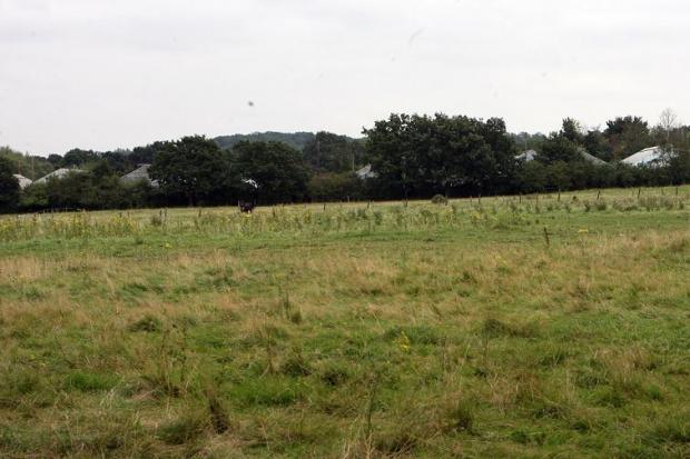 East London and West Essex Guardian Series: The land in Pick Hill which could soon be a 164-home development