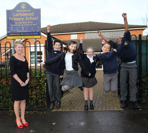 Lynne Harrowell and Year Six pupils celebrating the good news