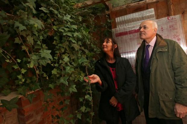 Mrs Graves shows Iain Duncan Smith the ivy in her shed