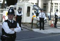 The scene last August at Westminster Magistrates Court as people suspected of involved in an airline bomb plot arrived to face charges (K6W9827)