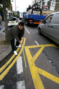 George Panteli with his measuring tape at the controversial box junction