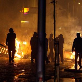 East London and West Essex Guardian Series: Loyalists set up burning barricades on Monday night on Newtownards Road, Belfast