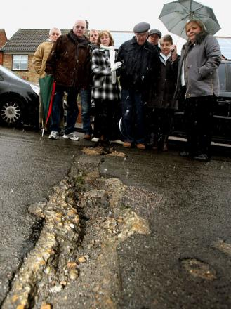Neighbours demand action on potholes