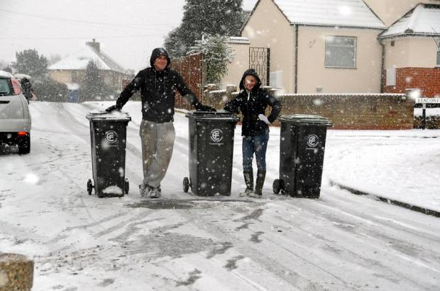 Michael Webber and Jessica Hammond with the bins they used to warn motorists in Shaftesbury Road, Epping