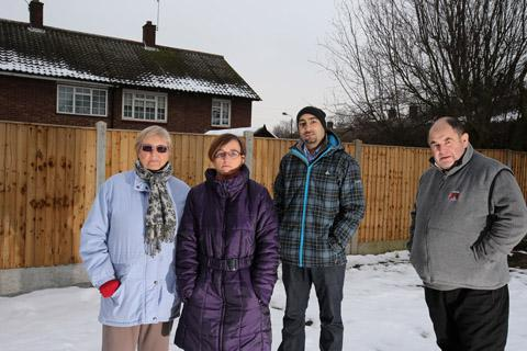 Dorris Issac, Helen Childs, Jay Singh and Dennis Barfield are concerned about a planned 3-storey development behind their homes.
