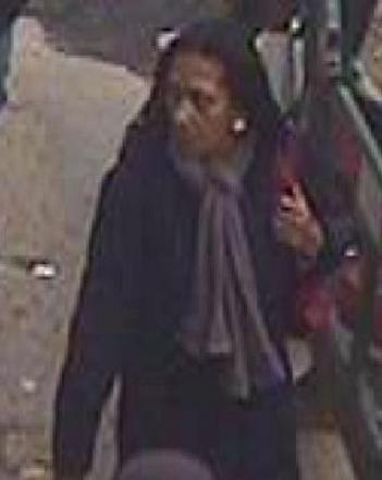 CCTV of a woman police want to question in connection with the mugging.