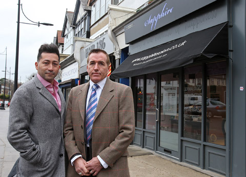 Jhon Jairo Yepes Giraldo and Paul Creane outside the Sapphire beauty salon.