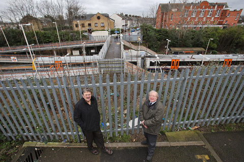 Richard Pout and Glenn Wallis of the Barking - Gospel Oak User Line Group at the site where a new walkway will link Queens Road with Walthamstow Central Station.