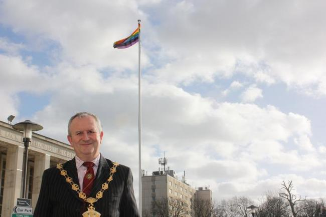 Mayor Richard Sweden with the Rainbow Flag flying outside the town hall