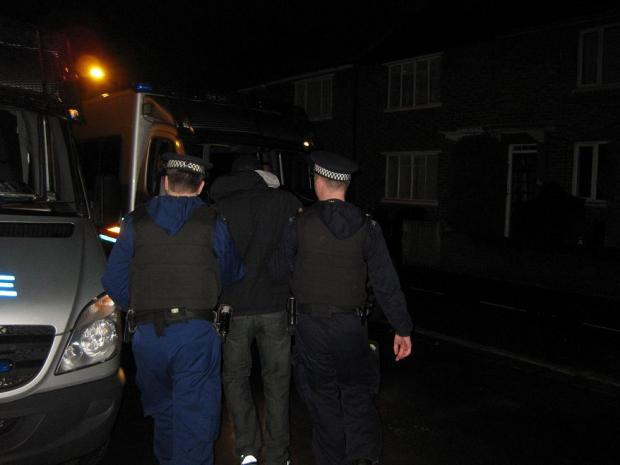 Police raid suspected gang members' homes