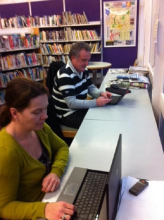 Virgin Media customers Denise Barnes and Joe Connell at work in Woodford Green library