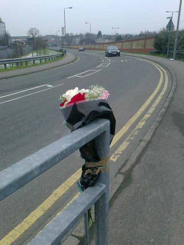 Flowers at the scene of the crash. (WF1402-FLOWERS).