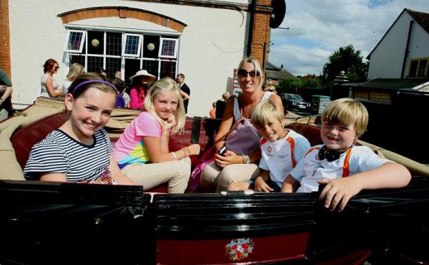 Last year's Love Loughton fun day event - Hayley Thompson with children Lara, Grace, George and Joseph about to go out on a horse and carriage ride