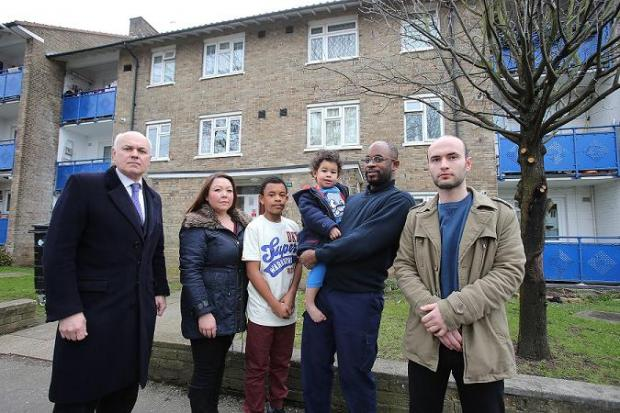 MP Iain Duncan Smith meets Mel Byrne, children Nathan and Lewis, Wayne Hewitt and Afrim Reka about their nightmare neighbour in Churchill Terrace, Chingford.