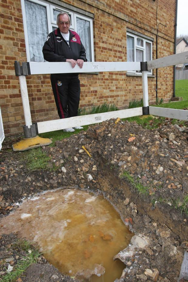 East London and West Essex Guardian Series: Resident David Childs with the broken pipe.