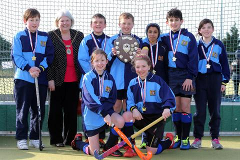 Winning hockey team from Bancroft's School with deputy Mayor Councillor Elaine Norman at the Redbridge Mini-Games. EL34952-2