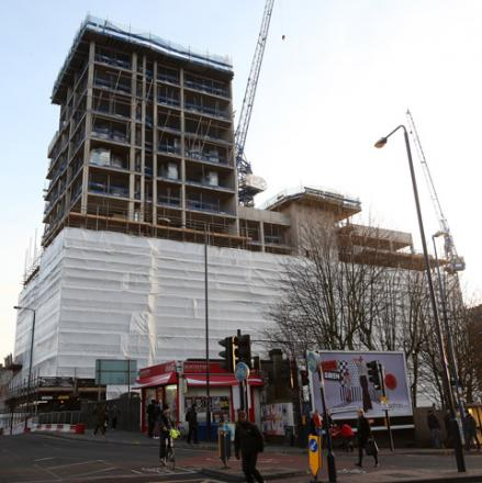 Tower block build halted after bricks fall from site
