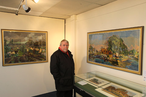 Keith Miller Walthamstow Historical Society with two of the paintings on display in Vestry House Museum.
