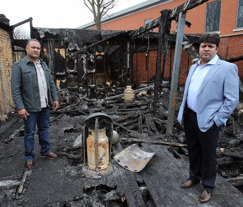 Khalid Rana and Shahazad Rana in the fire damaged cafe.