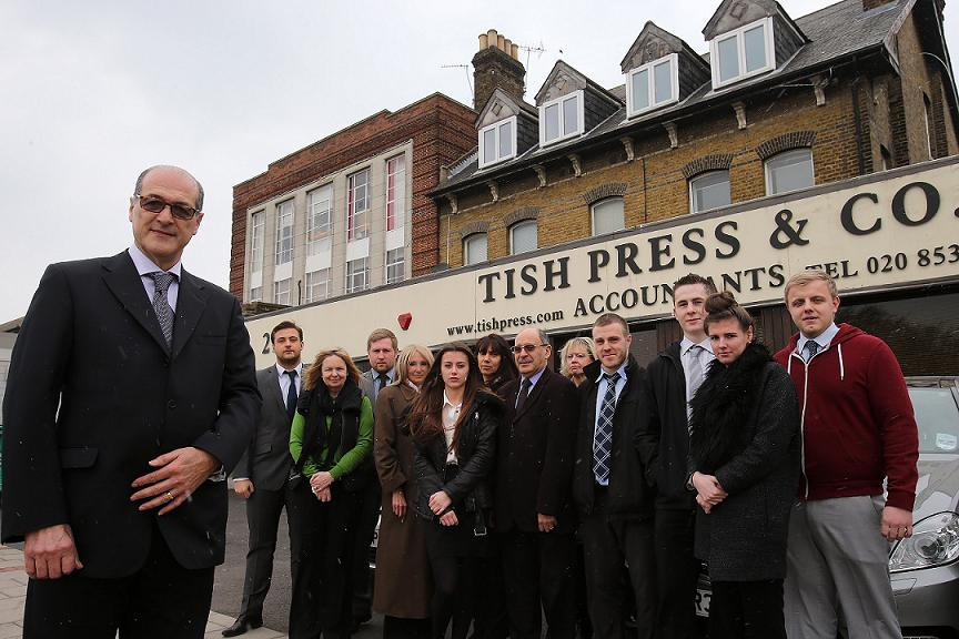 Raymond Tish with staff from Tish, Press and Co