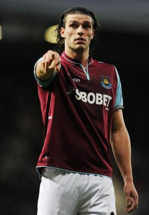 Andy Carroll faces a challenge to get back in the side: Action Images