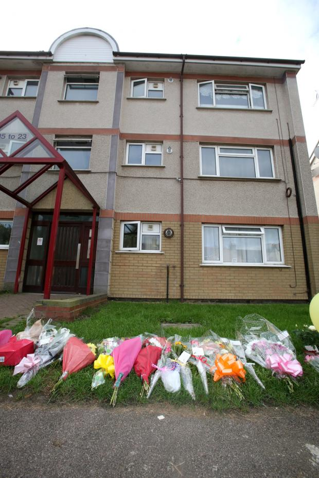 East London and West Essex Guardian Series: Tributes left at the murder scene