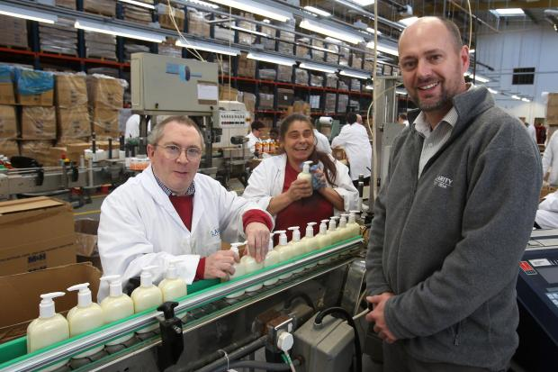 Billy Bass, Sandra Spencer and Chief Executive Jeremy Robinson in the Highams Park factory.
