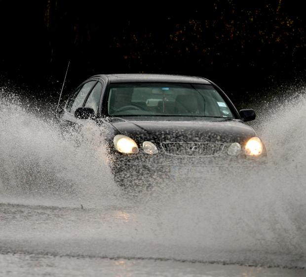 Motorist drives through flooding at Stapleford Airfield