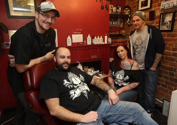 Andy Cifuentes Davis, Rob Chillingworth, Karen Maxey and Bradley Pickles in the Ouch tatoo parlour in